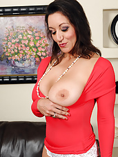51 year old Persia shows off her 38DD boobs before toying herself