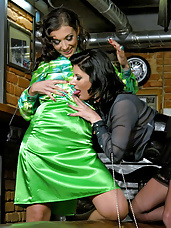 Clothed lesbians pleasuring