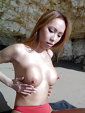 Asian posing outdoors