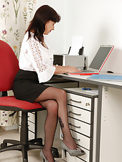 Natural titted office MILF Jenny H from AllOver30 chews her panties