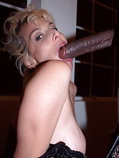 Buxom blonde playing with her tits while slurping a big cock and stretching her holes with it