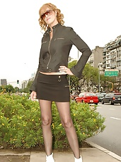 Big tit redhead in mini skirt and pantyhose shows off her hot body