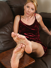 34 year old blonde Olga from AllOver30 displays long legs and sexy feet