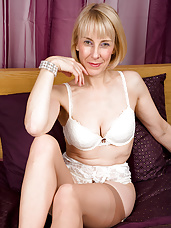 63 year old Hazel pulls her panties aside to display a full bush