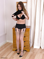 Sexy brunette Emma shows her FF stockings and black heels (Emma 2)