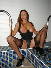 Jane swims in stockings with her big tits out