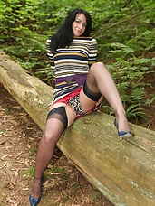 Big ass mature shows off her girdle in the forest