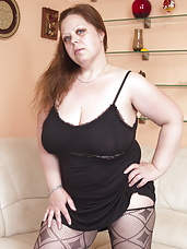 Huge breasted mama playing all alone