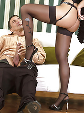 Babe does footjob in stockings