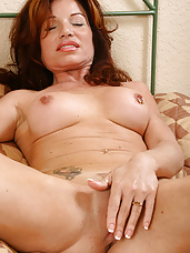 Exotic MILF spreads her legs and slips her fingers inside