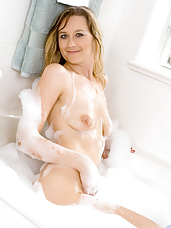 Seductive Nicole Logan takes a bubble bath and ends up masturbating with the rabbit toy