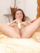 Sultry Anilos Maiky pleasures her mature pussy with a sex toy in her bedroom