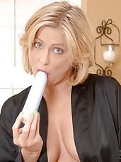 Totally nude cougar Lya Pink masturbates with a stiff dildo inside her bathroom