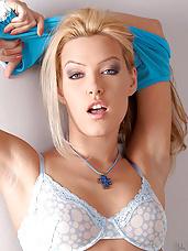 Sexy blond Sophie Moone masturbates