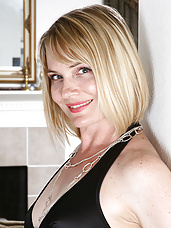 Elegant and mature Brittany slips of of her black dress in here