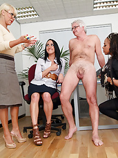 Executive tries to seduce new secretary but ends up stripped and wanked by the whole office