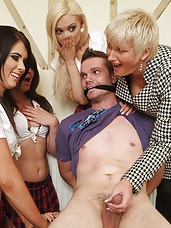 Schoolgirls take advantage of tied up man to strip and wank his cock