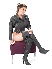 Biker Babe Hannah has her leather thigh boots on accompanied by her sexy biker jacket, and she very kindly unzips her jacket so you can enjoy the view