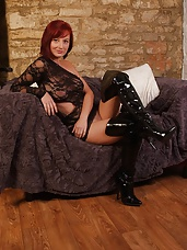 Horny Honey is in a very sexy fishnet top with gorgeous thigh high leather boots, and she can't help getting turned on and touching herself whilst wearing them