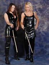 Sexy lesbian Dominatrixes in full leather outfits, enjoy teasing and a good spanking