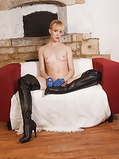 Cheeky blonde Milf Joss is teasing naked wearing only a pair of leather gloves and thigh high boots