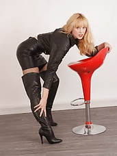 Horny blonde Joss slowly slips out of her leather jacket and mini skirt