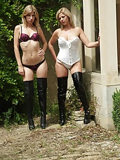 Two sexy blondes in lingerie and leather thigh boots