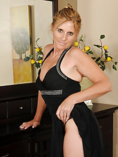 48 year old housewife Amanda Jean slips out of her elegant dress