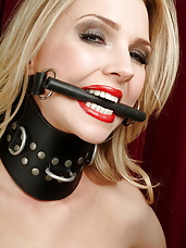 Sub blonde accessorised in rope, leather corset and training collar
