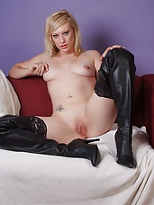 Nylon babe Axa is naked on the sofa except for her stockings, until she covers them up by putting on a lovely pair of long black leather boots and teases you