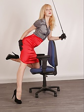 Horny office Mistress rubs her hairy beaver with her tight black leather gloves on