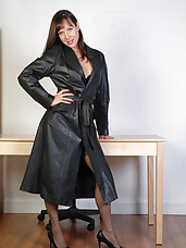 This long leather coat looks stunning on this sexy fetish wife