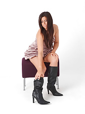 Horny brunette Leanne has a very sexy figure and naughty leather boots