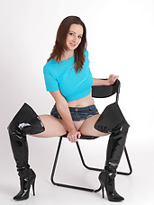 Sexy brunette with thigh high leather boots shows off her tight pussy