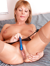 Hot sexy Elaine masturbates her dripping pussy with a dildo inside her room till she gets off