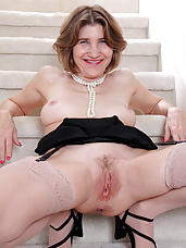 56 year old Bossy Ryder from AllOver30 opens her legs on the stairs