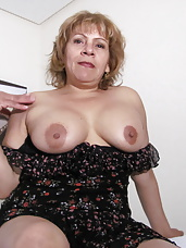 Horny mama playing with her rubber dildo