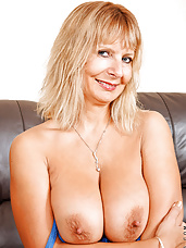 Horny Anilos Alex pinches her big boobs and spreading her pink pussy on the couch