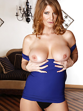 Busty redhead MILF seduces one of her son's friends into fucking her tight pussy on her bed.
