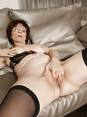 Naughty mature slut getting wet on the couch