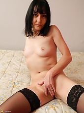 This naughty housewife loves to get wet