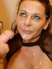 Cock loving Carly is surrounded by a group of well hung black studs and she is getting facialed.