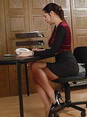 Horny secretary Ellen is showing her panties and then some