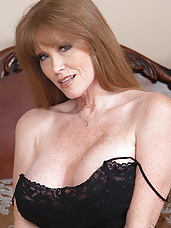 Busty redhead MILF fucks her son's friend and his big cock.
