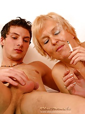 Hot old woman sucks young dick between cig puffs