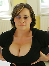 Huge breasted mama showing off her assets