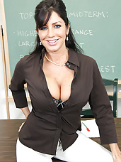 Busty brunette teacher is horny and decides to cut her student slack by fucking him in the classroom.