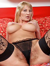 Milf Vanessa Sweets pleasures her hairy bush pussy wearing stockings