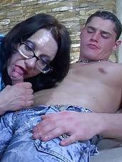 Glasses wearing mature greedily sucking off and taking up some fresh meat