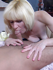 Cock-hungry blonde milf gags on a studly young dick before jumping on top